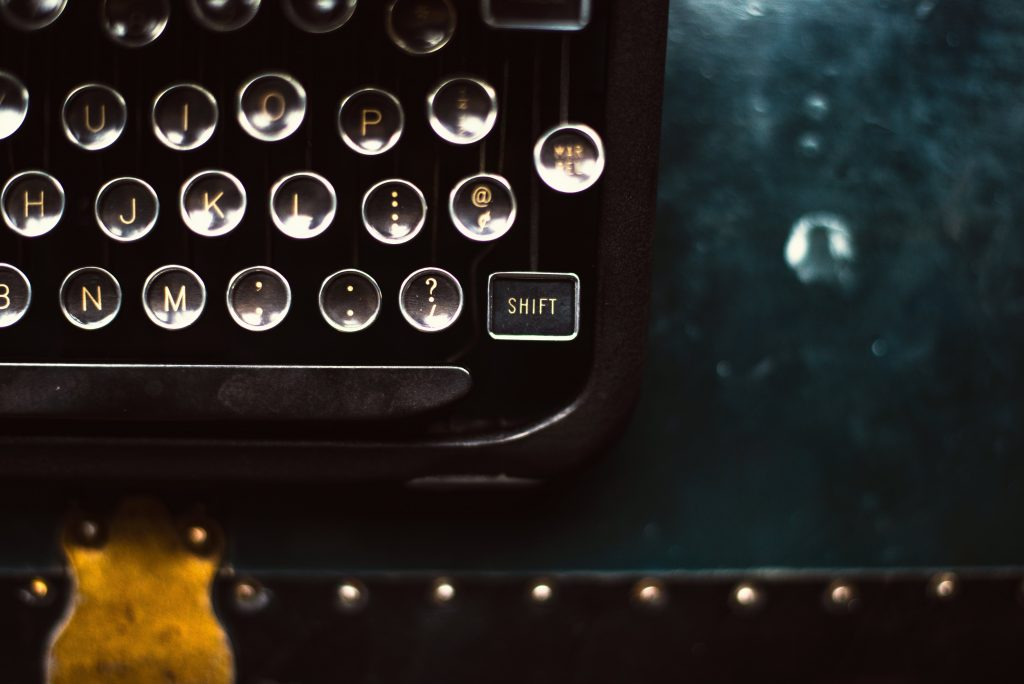 Image of vintage typewriter focus on the shift key