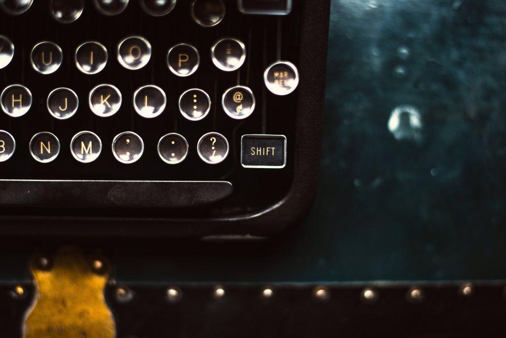 Image of vintage typewriter focus on the shift key