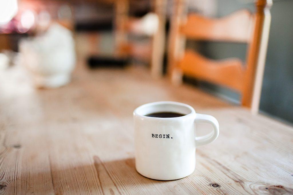 Mug with Begin written on it.