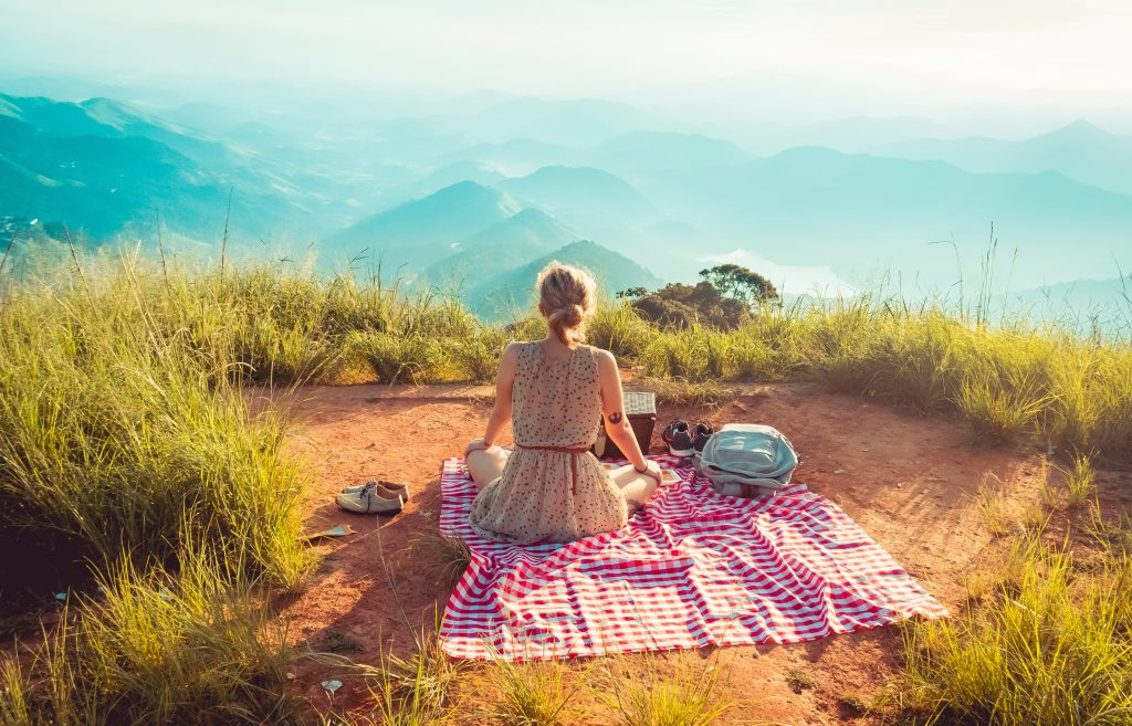 Picnicing on the top of a mountain.